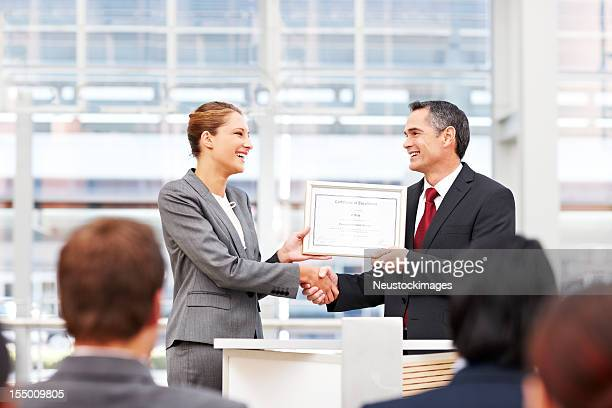 Businesswoman Receiving an Award