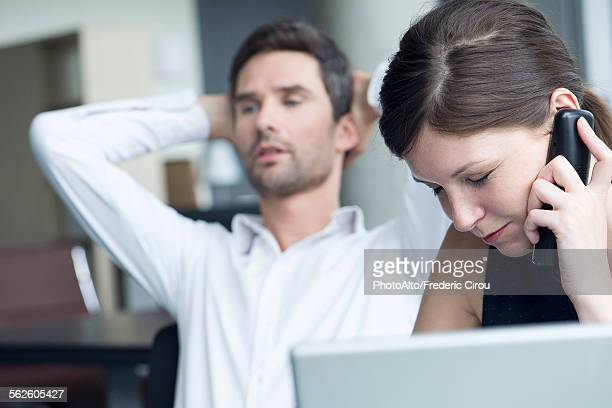 Businesswoman receiving bad news over the phone