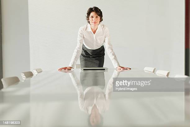 Businesswoman reflected in table
