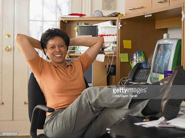 Businesswoman relaxing at her desk