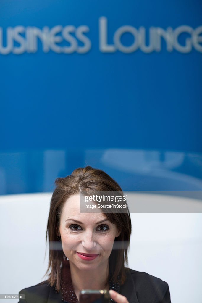 Businesswoman relaxing in lounge : Stock Photo