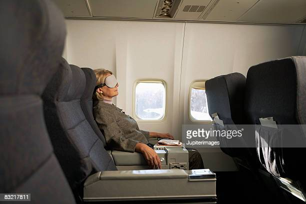 Businesswoman relaxing on airplane