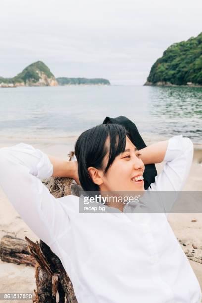 Businesswoman Resting At Beach