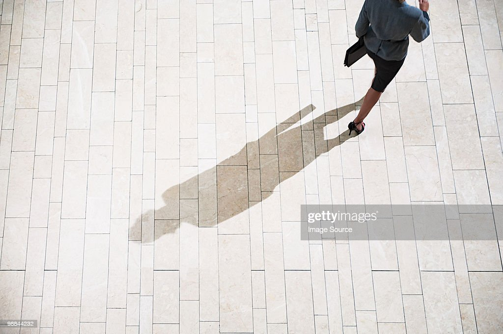 Businesswoman running in lobby