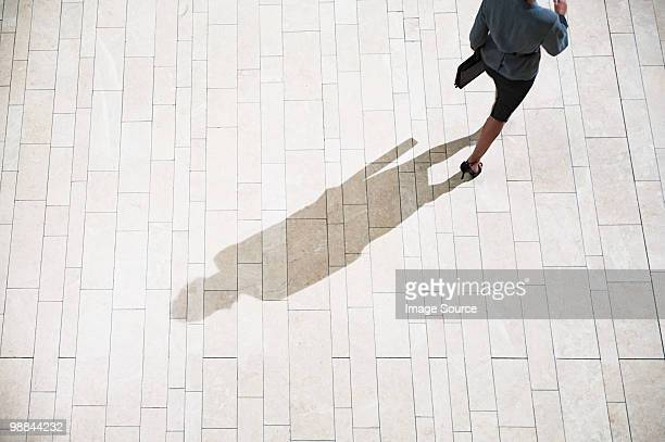 Businesswoman running in lobby