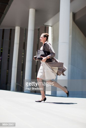 Businesswoman running outdoors
