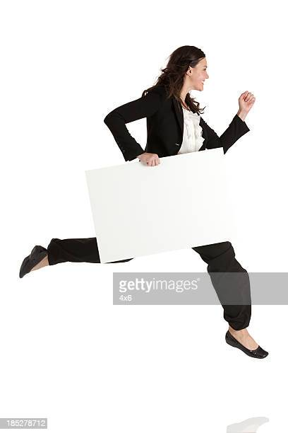 Businesswoman running with a placard