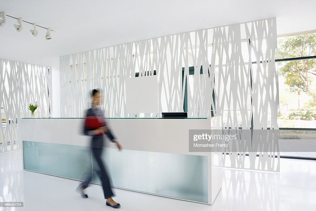 Businesswoman rushing through office lobby