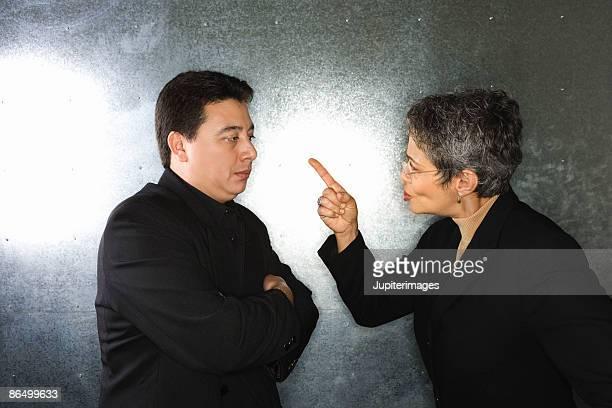 Businesswoman scolding businessman