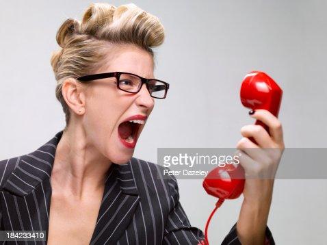 Businesswoman screaming down phone