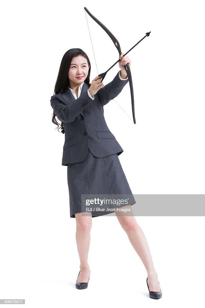 Businesswoman shooting an arrow