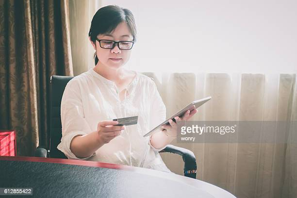 Businesswoman shopping at hotel room