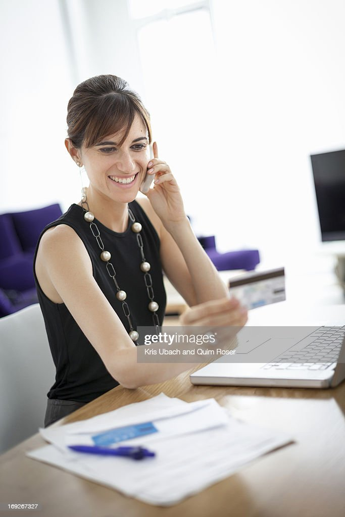 Businesswoman shopping on phone : Stock Photo