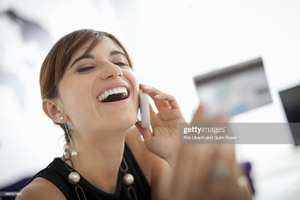 Businesswoman shopping on phone : Stock Photo