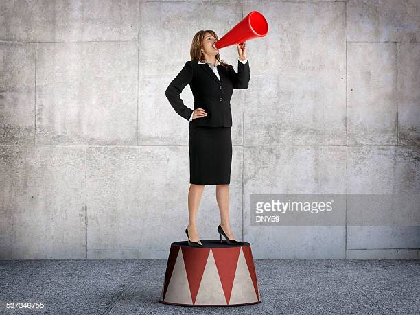 Businesswoman Shouting From Pedestal