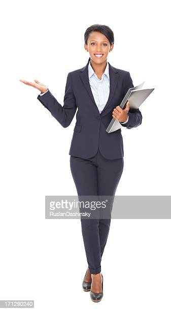 Businesswoman showing copy space over white background.