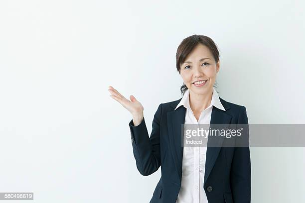 Businesswoman showing something by hand