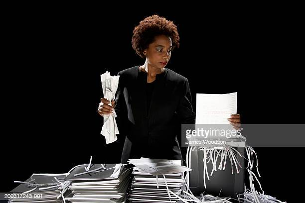 Businesswoman shredding documents