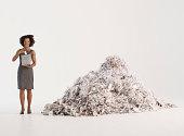 Businesswoman shredding paper
