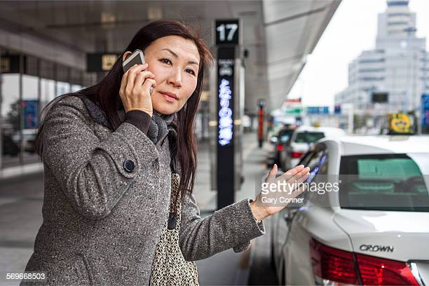 Businesswoman signals for taxi