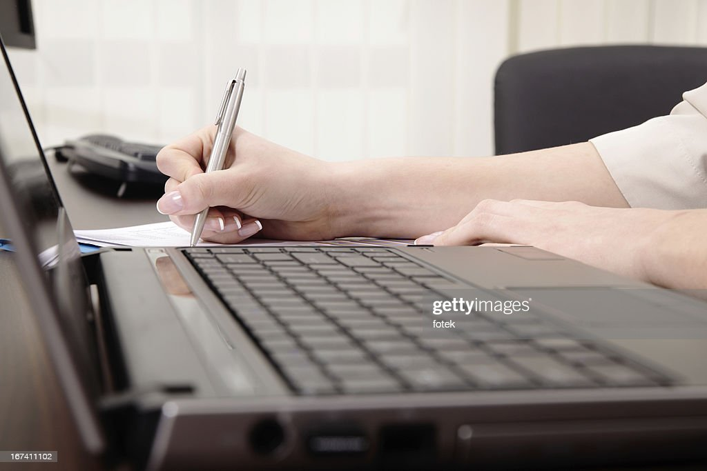 Businesswoman signing a report : Bildbanksbilder