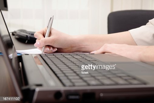 Businesswoman signing a report : Stock Photo