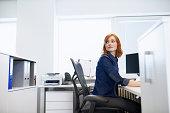 Businesswoman sitting at a desk