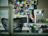 Businesswoman sitting at desk in office smiling