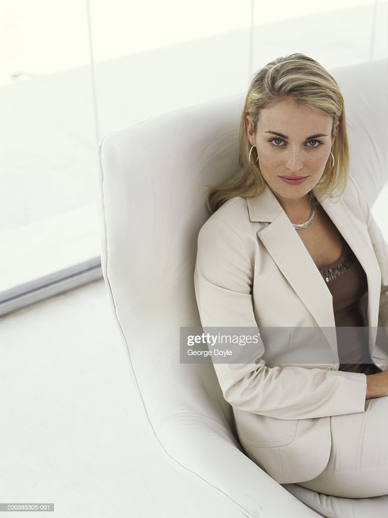 Businesswoman sitting in armchair portrait elevated view for Sitting in armchair