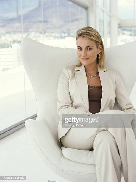 Gorgeous george stock photos and pictures getty images for Sitting in armchair