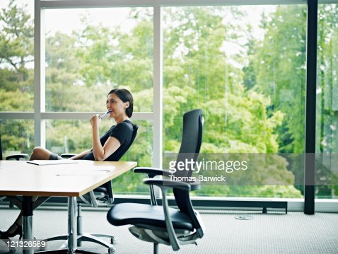 Businesswoman sitting in chair in conference room