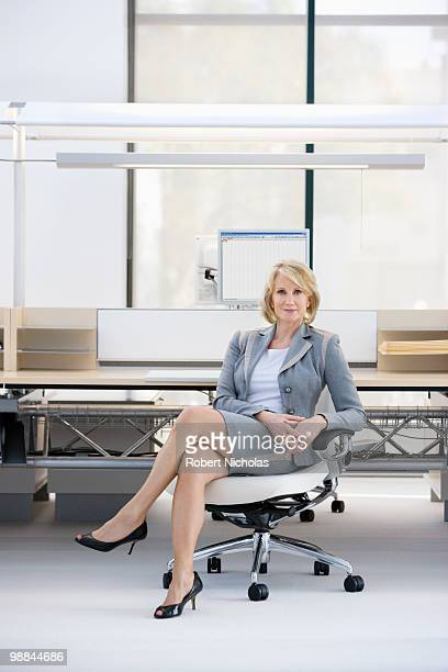 Businesswoman sitting in chair in office