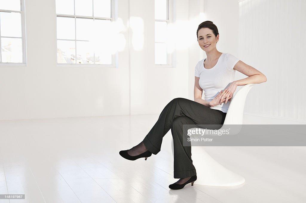 Businesswoman sitting in lobby area
