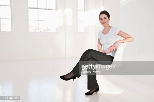 Businesswoman sitting in lobby area