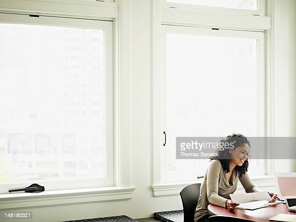 Businesswoman sitting in office in discussion