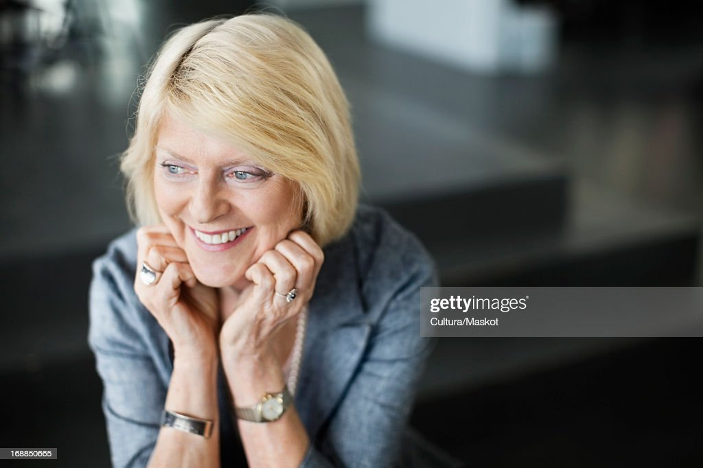 Businesswoman sitting in office : Stock Photo