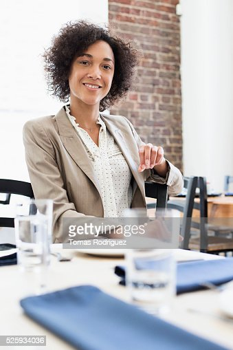 Businesswoman sitting in restaurant : Stock Photo