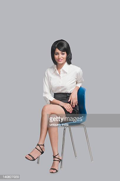 Businesswoman sitting on a chair and smiling