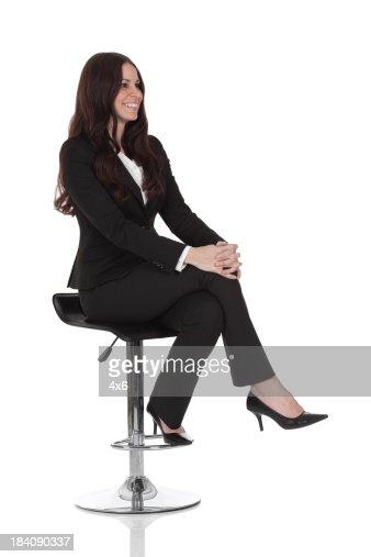Businesswoman sitting on a stool