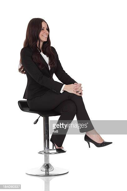 Businesswoman sitting on a stool