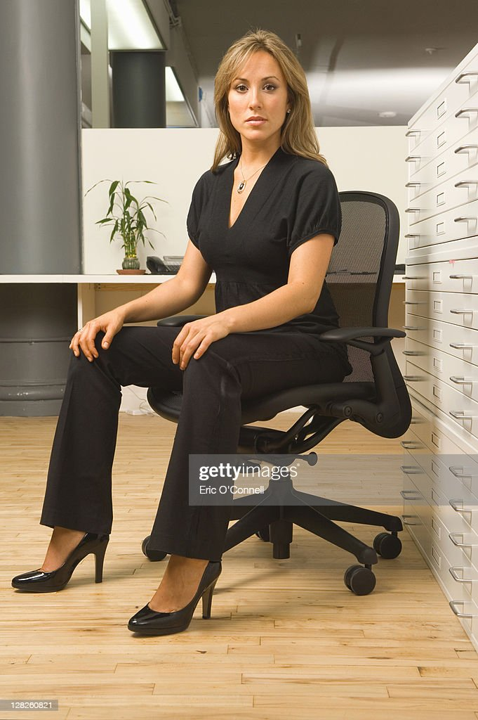 Businesswoman sitting on chair in office
