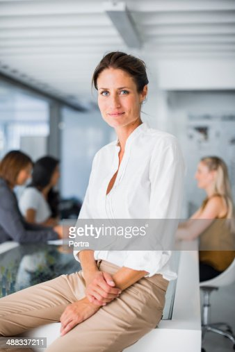 Businesswoman sitting on conference table