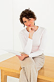 Businesswoman sitting on table