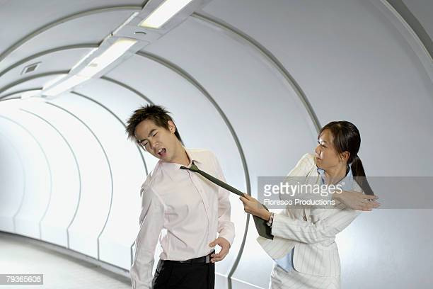 Businesswoman slapping businessman in corridor