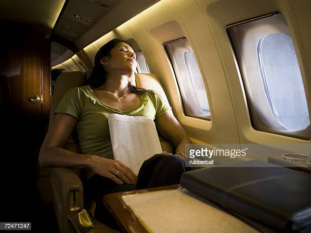 Businesswoman sleeping in an airplane