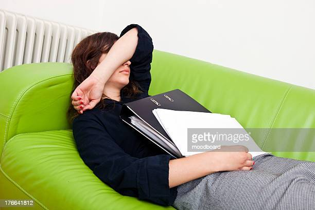 Businesswoman sleeping on a sofa