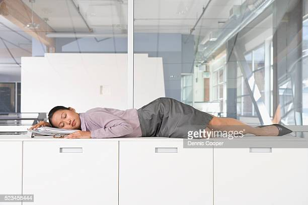 Businesswoman Sleeping on Counter at Work