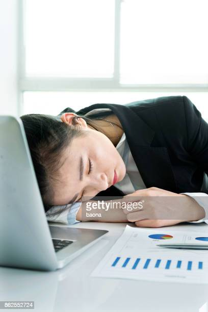 Businesswoman sleeping on the table
