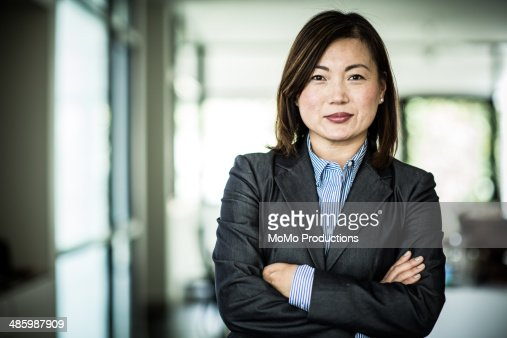 businesswoman smiling at camera : Stock Photo