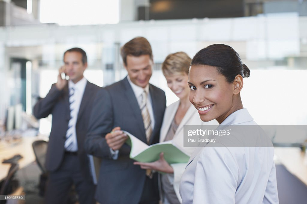 Businesswoman smiling in office : Stock Photo